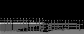 Podélný řez návštěvnickou a administrativní částí v místě amfiteátru. Pod amfiteátrem je umístěn vinný sklep. Administrativní část kopíruje sklon terénu. Úroveň vstupu do administrativní části je ve stejné výšce jako výrobní dvůr.