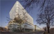 Pohled na budovy Českého istitutu informatiky, robotiky a kybernetiky z ulice Jugoslávských partyzánů